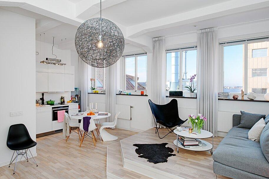 Кухня снизу подиума в дизайне гостиной 30 кв м - фото